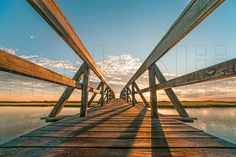 This is a landscape photograph of the Sandwich Boardwalk Bridge at sunrise, Mill Creek, New England, Cape Cod, Sandwich, Massachusetts, USA. This extraordinary masterpiece is part of theMikolji Artwork collection.