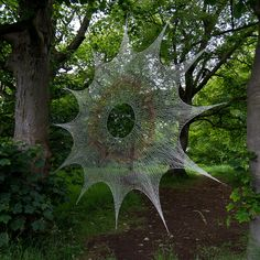 Over Here by Shane Waltener A diameter web knitted with circular knitting needles and four strands of multi-coloured fishing line using a technique inspired by Shetland lace. Image Nature, All Nature, Amazing Nature, Spider Silk, Spider Art, Spider Webs, Giant Spider, Land Art, Macro Photography