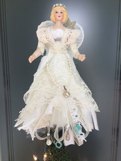 This OOAK Shabby Chic Angel sits atop a real Vintage Rusty Bedspring by ChristmasTreeTops on Etsy