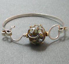 Bangle Bracelet in Sterling Silver with Beaded Latch Closure, Artisan Hammered Silver Bangle Bracelet. $ 50.00, via Etsy - stoneandsterling.
