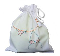 Bikini bag with wet bag to keep your wet bikini in, super cute printed and hand embroidered design. Made in Egypt.