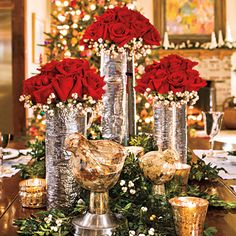 Create an elegant Christmas centerpiece with red roses surrounded by white tallow berries in silver vases made to resemble birch bark. Tuck pieces of boxwood garland and sprigs of berries around the base of the vases; add votives to finish the look.