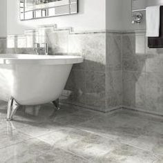 Advanced ceramic print technologies allows this Wickes cappuccino light grey gloss ceramic tile to bring a wonderfully authentic and contemporary marble finish to any home. Small Bathroom Wallpaper, Grey Bathroom Tiles, Bathroom Tile Designs, Grey Tiles, Grey Bathrooms, Bathroom Interior Design, Bathroom Flooring, Interior Decorating, Bathroom Ideas