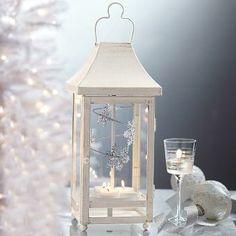 Great piece to have near your guest book.  While your guests are waiting to sign, this piece is a real eye catcher as the inside (snowflakes or birds) spins!   http://www.partylite.biz/legacy/sites/adrians/productcatalog?page=productdetail&search=true&sku=P91111