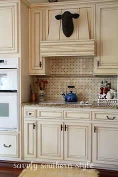 cream cabinets with light antiquing.  The backsplash isn't bad, either.