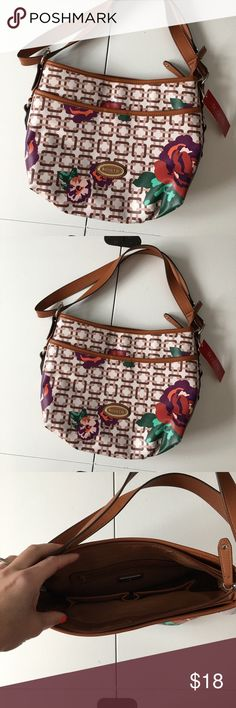 """NWT Cognac & Floral Print Crossbody Bag Large Brand new with attached tags. Measures 13 x 10 x 4."""" Retail $60. Price and shipping are firm. Please note: strap is doubled-up in photos so it is a regular shoulder bag. It can be adjusted so it is crossbody as well. Rosetti Bags Crossbody Bags"""
