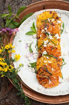 Why not swap the standard spring mix for a slightly smoky broiled-citrus salad topped with olive oil, sea salt, feta and mint?