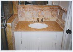 Granite bathroom vanity counter top and tile backsplash. http://www.jpmoorehomeimprovements.com/our-services/bathroom-remodeling/