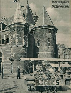 1937 - 1940. View of the Waag at the Nieuwmarkt. The Nieuwmarkt is a square in the center of Amsterdam. The square is dominated by a building known as the Waag, originally a gate in the city walls, but later converted into a weighing house after the walls were demolished in the 17th century. Today there are over 20 cafés on the square. The square also hosts a daily market, organic food market on Saturdays and an antique market on Sundays in the summer months. #amsterdam #1940 #Nieuwmarkt
