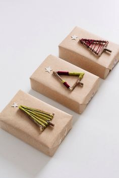 Wrapped Twig Gift Decorations. Perfect for nature lovers or holiday gifts. Assemble twigs into a tree, glue than wrap twine.  http://fellowfellow.com/diy-christmas-tree-gift-toppers/
