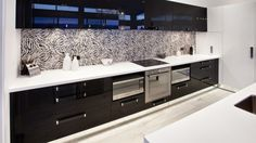 This kitchen has the 'wow' factor! The crisp black and white kitchen with Corian countertops and high gloss acrylic cabinetry Two Tone Kitchen, Kitchen Black, Black Kitchens, Corian Countertops, Kitchen Gallery, Wow Products, Double Vanity, Black And White, Two Toned Kitchen