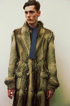 This dude's going full-on derelicte with his Prada fur.
