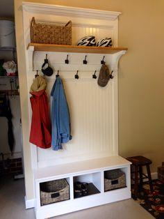 Make a mud room storage area in the garage.