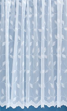 Delicately embroidered white net curtains that let in plenty of light but keep out prying eyes.