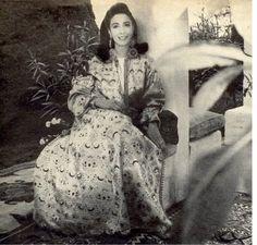 "little augury, kaftan, ""Mrs. Ahmet Ertegun"" as Vogue put it in 1966 wearing a gold Moroccan caftan as an evening coat"