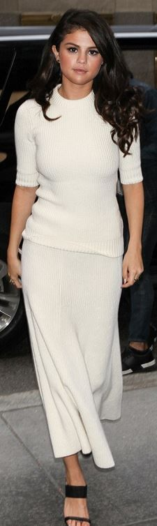 Who made  Selena Gomez's black sandals, ribbed white sweater, and maxi skirt?