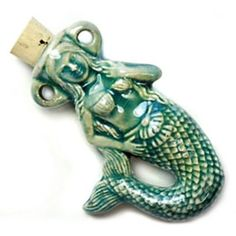 This handmade mermaid clay bottle with a blue green raku glaze from Peru measures 50 x and is for sale online in the natural beads section at Harlequin Beads and Jewelry bead store. Wear clay vessel pendant filled with essential oil or fragrance. Jewelry Art, Beaded Jewelry, Unicorns And Mermaids, Bead Store, Glaze, Blue Green, Essential Oils, Lion Sculpture, Fragrance