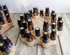 2-tier rotating spindola essential oil display wooden middle section alone with oils