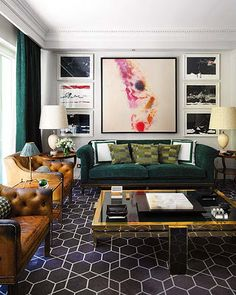 I love the colors and patterns in this room! #living #room #rug #art #blue #teal #peacock #pink #magenta #leather #velvet
