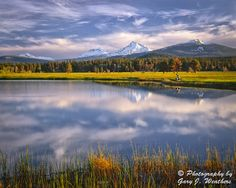 Sisters Mountains from Black Butte Ranch by Gary Weathers.