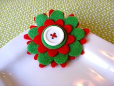 Red and green felt flower