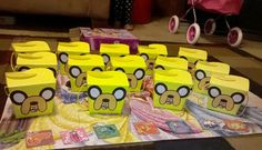 While searching online for Adventure Time birthday party ideas for my daughters 5th birthday I ran across a photo of some goodie bags someone had made by gluing Jake the dogs face on some yellow bags...I used yellow boxes instead so the face fit flat  against the box & the edges didn't stick out.
