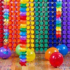 "A wall of cups in rainbow stripes makes a backdrop that screams ""photo op!"" for a rainbow party or kids birthday party."