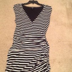 Black and white striped dress Cute, just below the knee ruched dress.  Mossimo brand sized Medium.  Cute dress to wear as is or pair with a nice blazer or jean jacket. Never worn, with tags Dresses