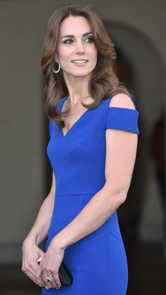 We're used to seeing the duchess in pretty sheath dresses and fascinators, but when Kate Middleton throws on an evening gown, she looks exactly like a modern-day princess. At Thursday evening's reception for the 40th anniversary of SportsAid, an organization that helps to fund the careers of young athletes, Kate proved our point in an appropriately royal blue Roland Mouret gown. The elegant look stayed true to Kate's classic aesthetic, though you'll notice one trendy twist. With cutout…