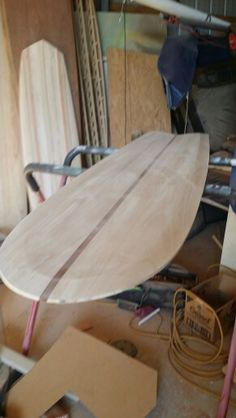 Wood alaia surfboard with dark cedar stringer. ...I'm going to do more of these.