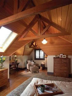 Spacious #attic bedroom. Gorgeous wood #paneling.