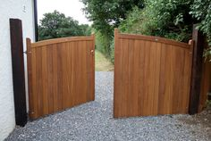 The Chappelwood design. Sweeping bow top with vertical cladding. Oil finish to protect and enhance the iroko hardwood. Metal Garden Fencing, Wooden Garden Gate, Fence Design, Garden Design, Wooden Electric Gates, Wooden Gate Designs, Timber Gates, Wood Gates, Double Gate