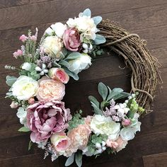 This wreath was inspired by an eclectic combination of pale tones and cotton accents creating a fun mix of texture that transitions well through the seasons. This wreath is perfect for interior or exterior use and would be a beautiful addition as a wedding accent! The purchase of this
