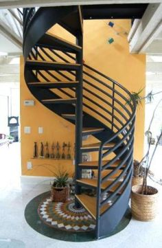 Contemporary Staircase with black metal spiral staircase