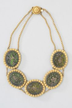 """Said to be practiced in only one location in India, the """"thewa"""" technique involves the fusing of gold-foil onto glass to create elaborately designed jewelry.  Thewa-Work Necklace, c. 1850, India"""
