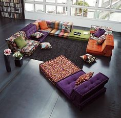 This would be a comfortable set up for a lounge area.. Not sure about the fabric patterns