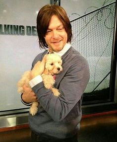 Norman Reedus holding a puppy