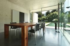 Modern Concrete Living Room With Thick Wood Table Dining Area Lighting