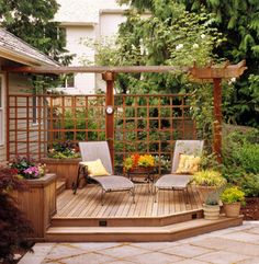 These raised planters and trellis is what I envisage at the bottom of our new garden