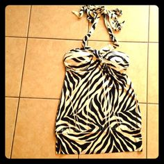 Silky zebra halter top! Never worn! Is lined in the busy and is stretchy! Feel free to make an offer! Can't find the size but guessing it's a medium! Wet Seal Tops Tank Tops