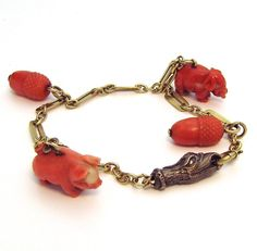 Antique Victorian 14K Gold Serpent Snake Head Hand-Carved Coral Charm from charmalier on Ruby Lane