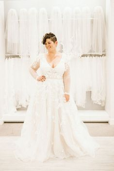 89ea5cd52fa7 A woman with short brown hair stands in a long sleeve lace wedding gown in  front of a wall of veils at David s Bridal · Simple Wedding Dress ...