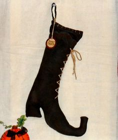 Witch's boot idea. Easy DIY with heavy fabric. Paint with layer of acrylic craft paint for texture and more stiffness. Sew on laces. Stuff with things from your garden or walks --- like cat tails, sticks, butterfly bush twigs.