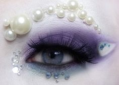 Purple and clear crystals accent colorful purple eye make-up and a pearl brow. Idea for Ursula eye makeup. Fantasy Make Up, Fantasy Hair, Makeup Art, Beauty Makeup, Hair Makeup, Makeup Stuff, My Little Pony Rarity, Mermaid Makeup, Mermaid Eyes