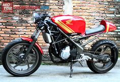 cbr250r cafe racer...i'd totally do this to my bike.