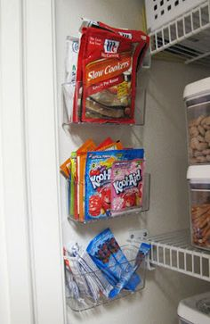Use empty side wall space for packets and snacks-  These under the sink storage containers also work perfectly to hold sauce and seasoning packets, drink mixes and more.  If you have more space, try small metal pails to the wall with cute chalkboard paint labels to hold lightweight items such as bags of goldfish for the kiddos.