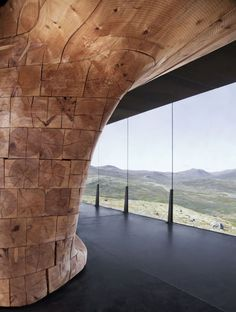 View of the Stacked Pine Beams in the Tverrfjellhytta Wild Reindeer Pavilion in Norway by Snøhetta