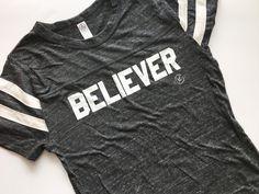 BELIEVER Adult Football Tee - Eco Black
