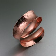 Elegant and exotic with raw, natural appeal, this handmade Chased #Copper #Cuff is exquisite from every angle. The hand-hammered chasing adds a distinctive texture that compliments the sleek #anticlastic design. Cuff bracelets are the perfect way to add individuality to any ensemble for any occasion.