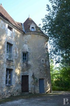 A 16th century manor house concealed amongst trees in the Perche area's French…